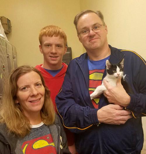 Kitten Tupper with adopting family