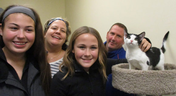 Kitten Twister with adopting family